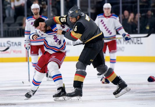 This image has an empty alt attribute; its file name is e5c980e0-fec3-493f-b0b5-bd8a46a1e09d-ap_rangers_golden_knights_hockey.jpg